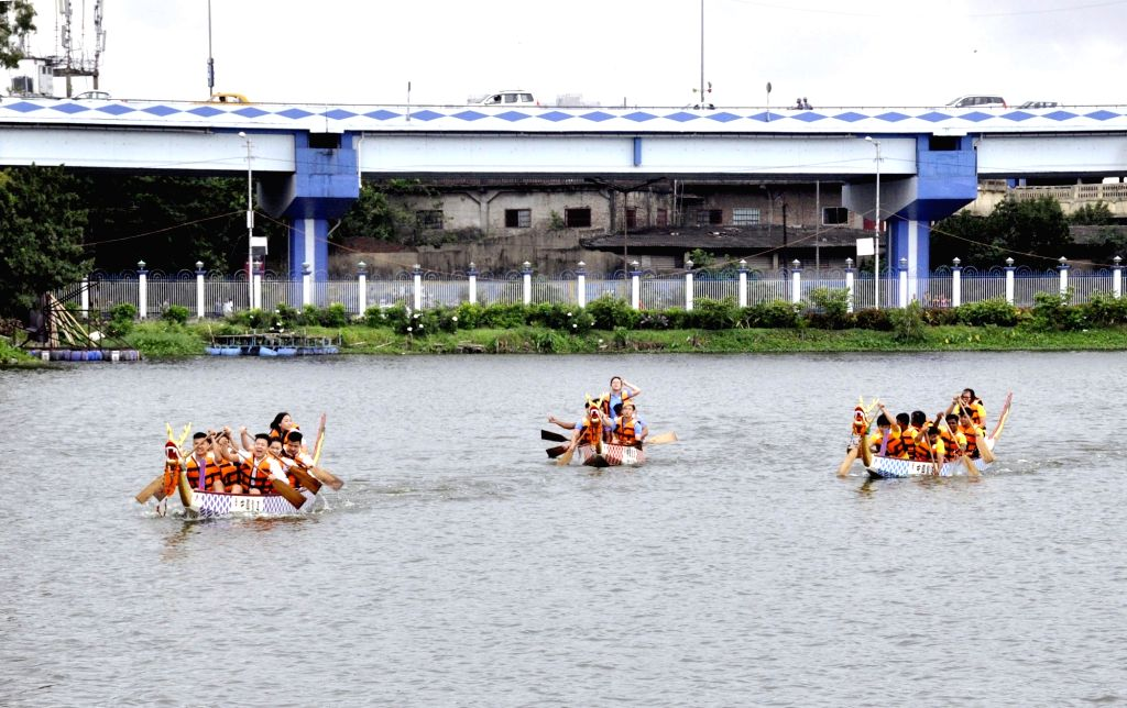 People of Chinese origin participate in a boat race ahead of the Dragon Boat Festival 2019,  in Kolkata, on June 2, 2019.