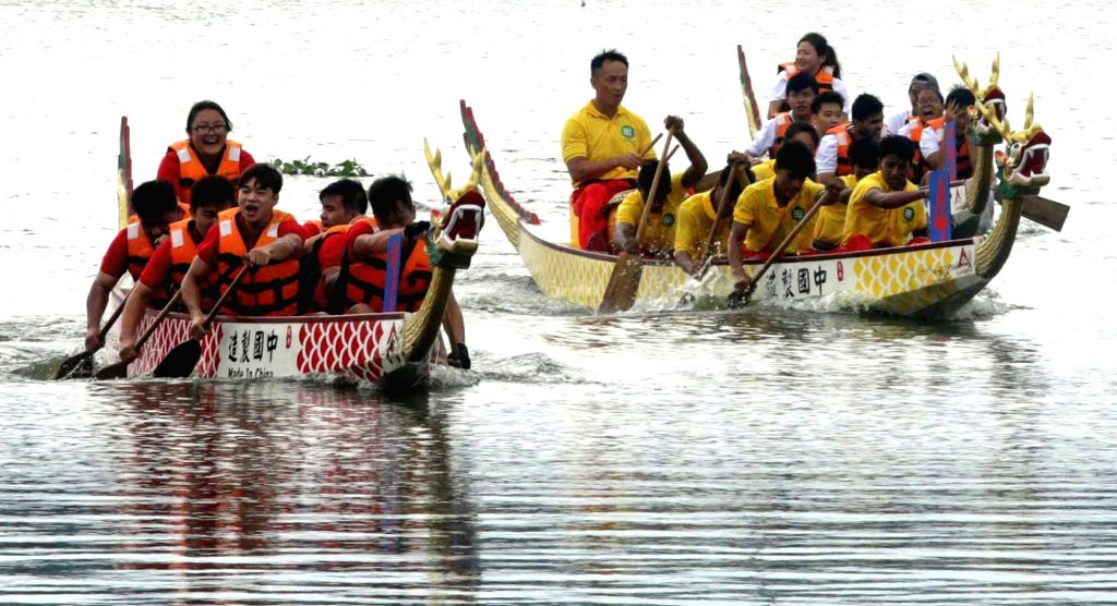 People of Chinese origin participate in the Dragon Boat Festival in Kolkata, on June10, 2018.