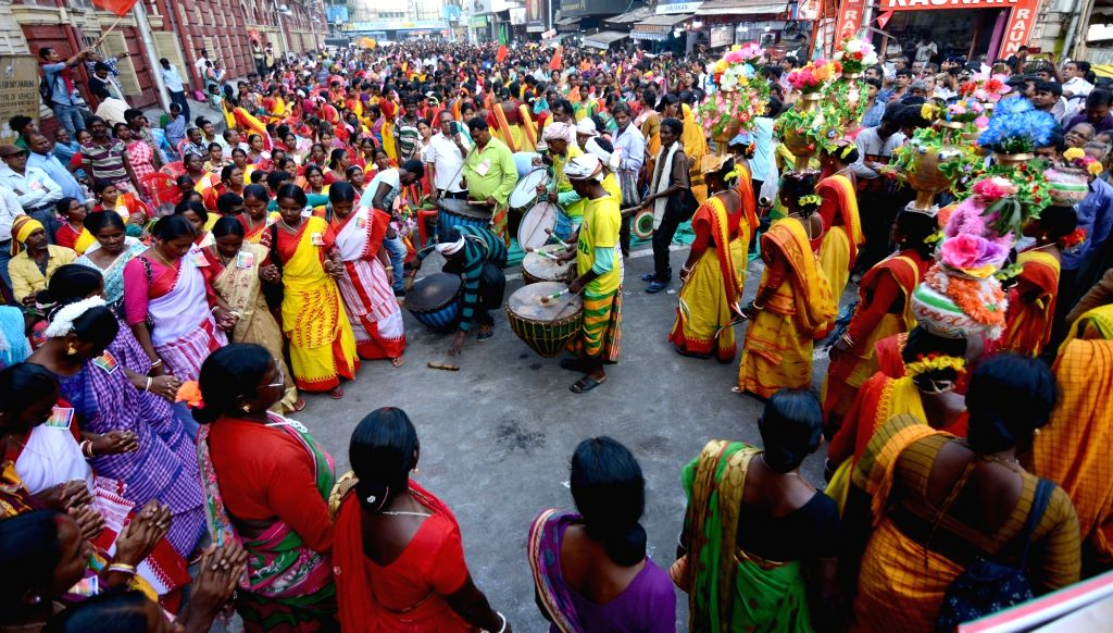 People of the tribal community participate in a demonstration organised by the CMI-ML to press for their various demands, in front of Kolkata Municipal Corporation (KMC) office on Nov 18, ...