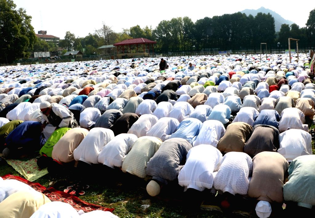People offer Eid namaaz in Srinagar's polo ground on June 6, 2016.