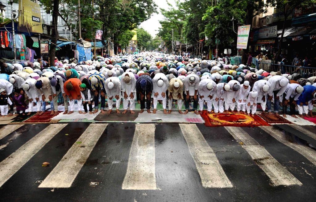 People offer namaaz during Ramadan in Kolkata on July 1, 2016. (Photo: IANS)