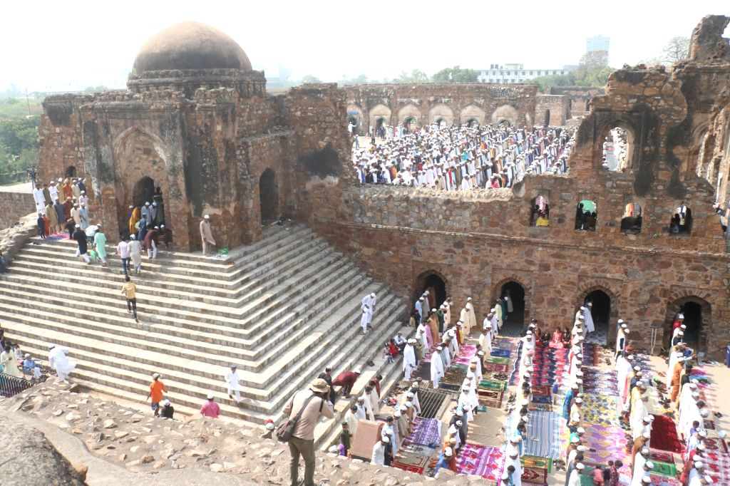 People offer namaz at Feroz Shah Kotla on Eid-ul-Fitr in New Delhi on June 5, 2019. - Feroz Shah Kotla