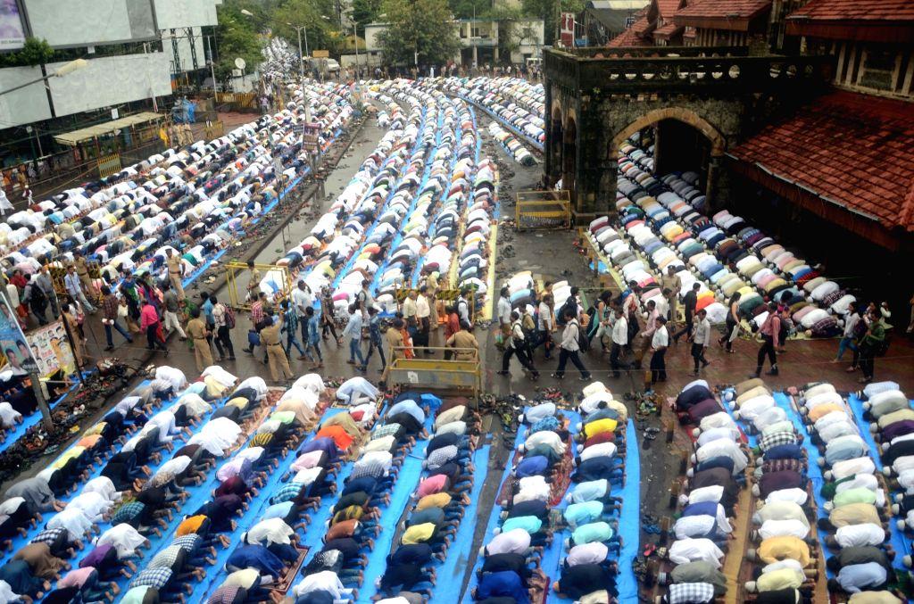 People offer namaz on Eid-al-Fitr at Bandra in Mumbai on July 7, 2016.