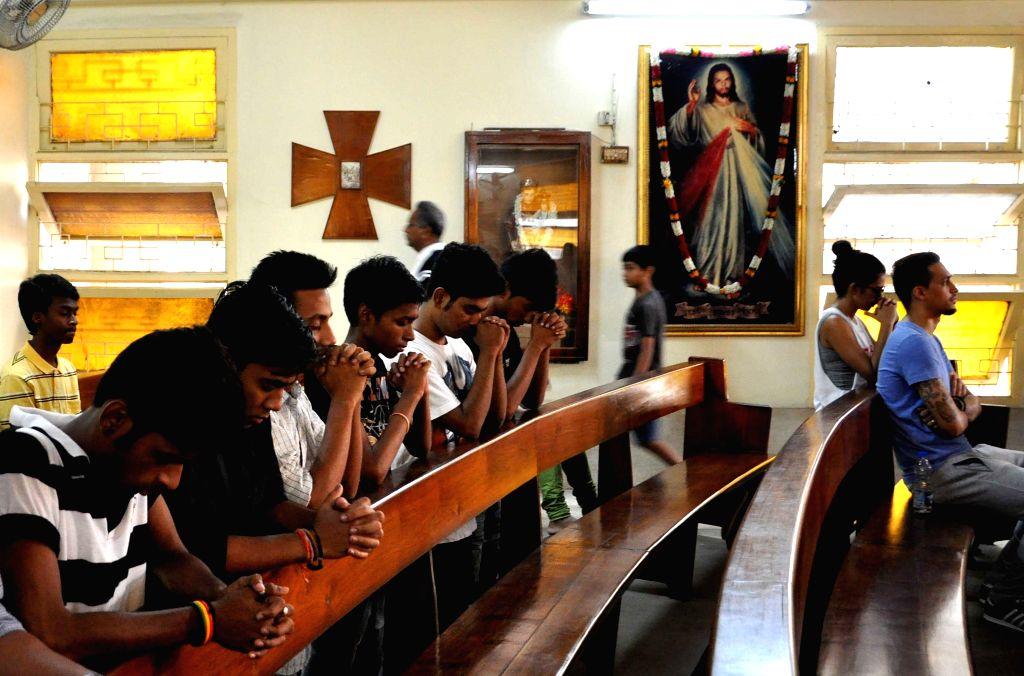 People offer prayers at a Kolkata Church of Good Friday in Kolkata, on April 3, 2015.