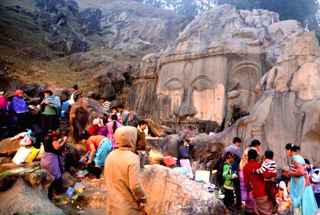 People offer prayers at Unakoti on Makar Sankranti in North Tripura on Jan 15, 2016. Unakoti is a historic Shaiva pilgrimage spot lies that 178 km to the northeast from Agartala.
