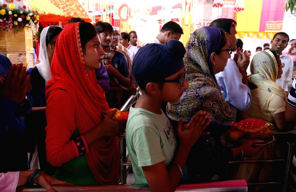 People offer prayers during Navratri in New Delhi, on Oct 2, 2016.