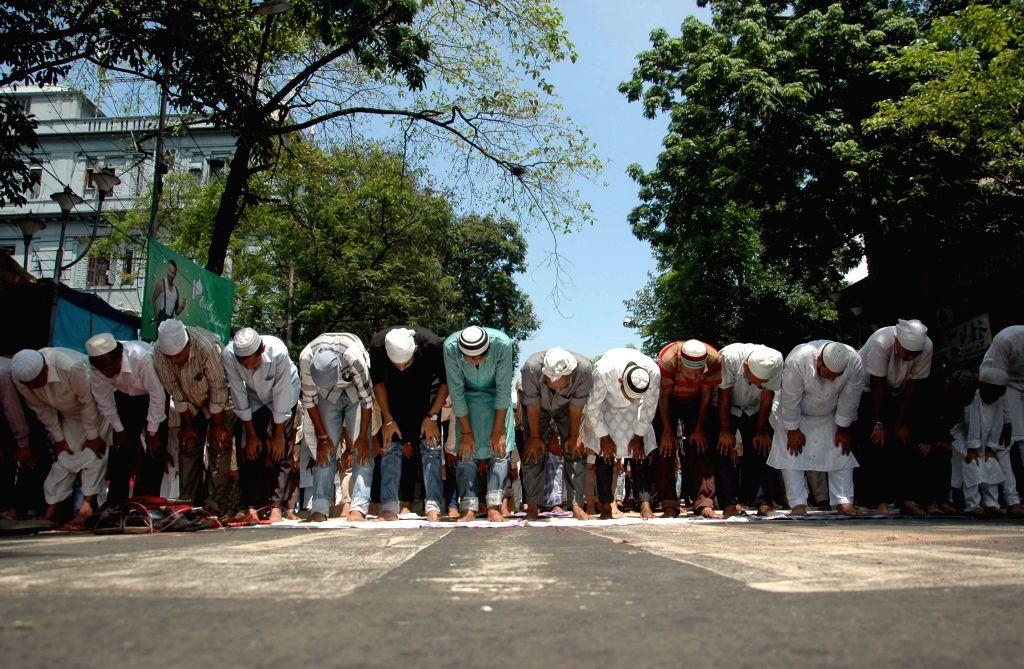 People offer prayers on Juma-tul-Vida, the last Friday of the holy month of Ramadan in at Tipu Sultan Masjid in Kolkata on July 25, 2014.