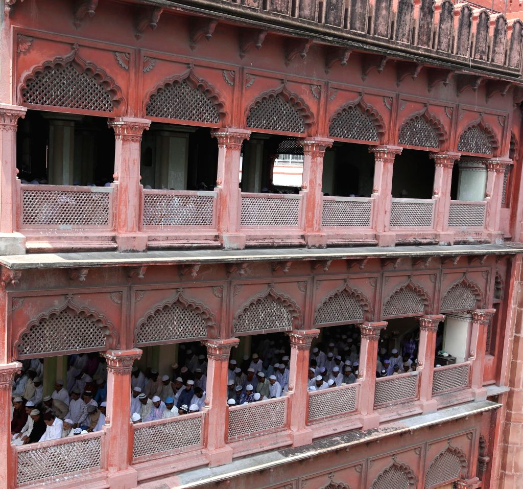 People offer prayers on Juma-tul-Wida, the last Friday of the holy month of Ramadan in at Nakhoda Masjid in Kolkata on July 25, 2014.