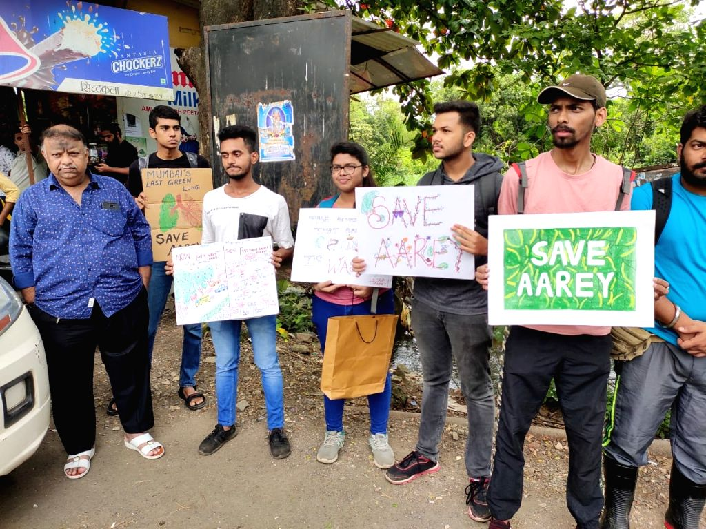 People opposing the proposed felling of trees in Aarey colony stage a demonstration against Maharashtra Government's decision to build Metro Car Shed, Metro Bhavan and cutting of 2,700 trees, ...