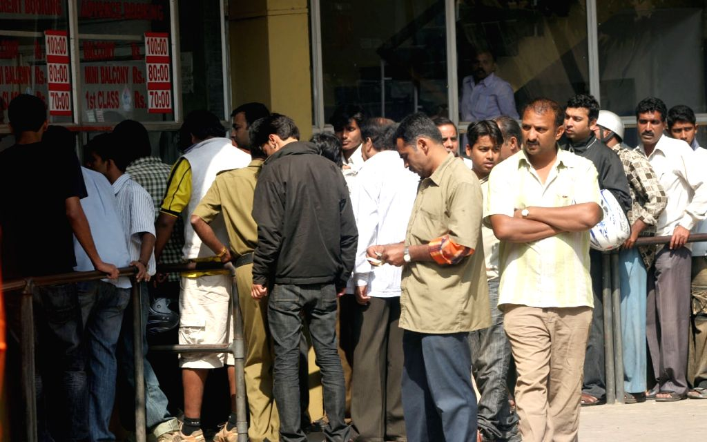 People outside a cinema hall in Bengaluru on July 4, 2017.