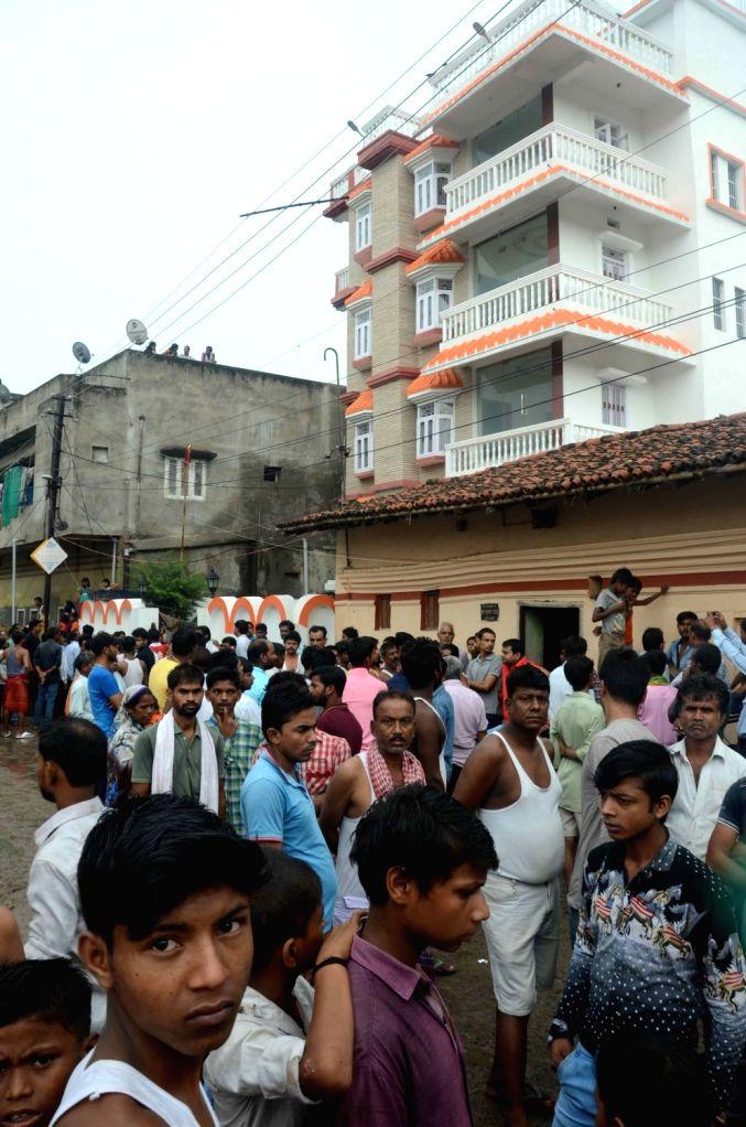 People outside the house of killed RJD leader Kedar Rai mourn his death in Patna on Aug 10, 2017. - Kedar Rai