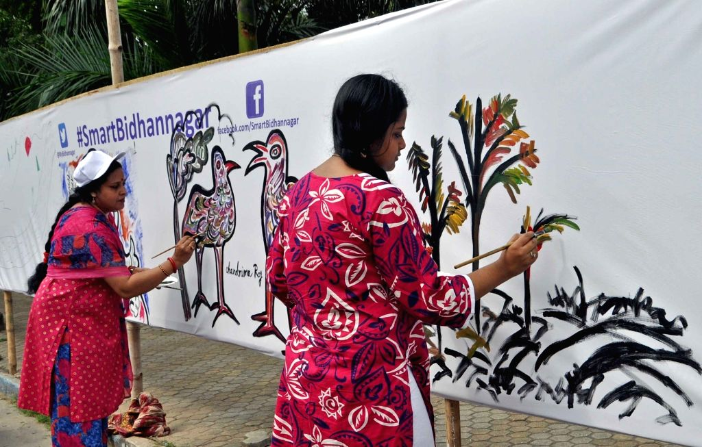 People paints on a canvas for support of `Smart Bidhannagar` in Kolkata on Oct 31, 2015.