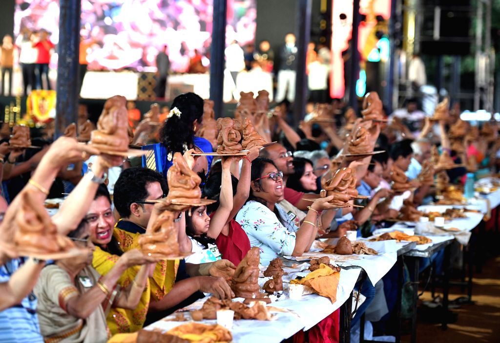 People participant in mass making of clay idols of Lord Ganesha, in Bengaluru on Aug 25, 2019. About 3000 participants attempted to create a Guinness World Record by sculpting their own ...