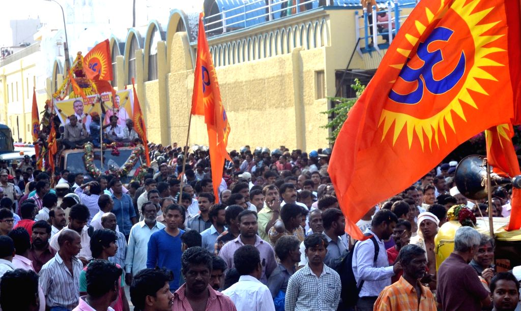 People participate at the funeral procession of RSS and BJP leader Rudresh R, who was hacked to death by two motorcycle-borne youths in Bengaluru on Oct 18, 2016.