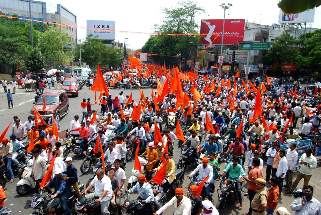 People participate during a procession organised on Hanuman Jayanti in Secunderabad on April 22, 2016.