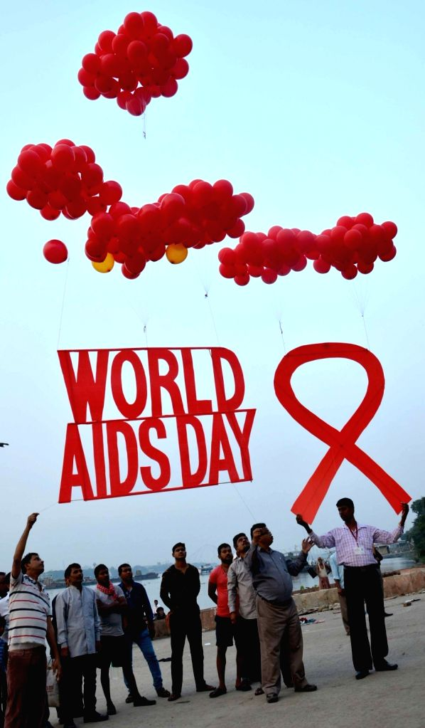 People participate during an AIDS awareness programme on the eve of World AIDS Day in Kolkata on Nov 30, 2016.