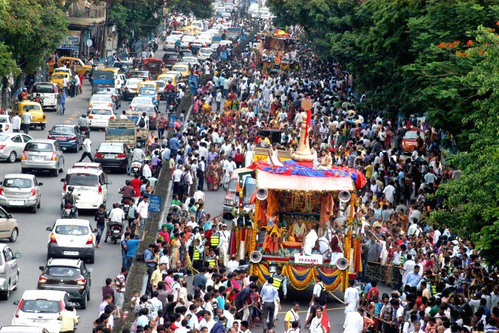 People participate during ISKON Rath Yatra celebration in Kolkata on July 6, 2016.
