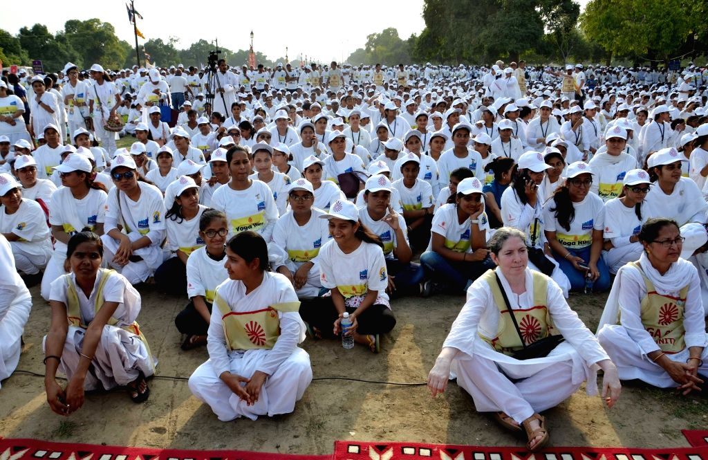 "People participate during the ""Yoga Run for Peace & Unity""  - a mini-marathon at India Gate to Rajpath in New Delhi on June 18, 2016."