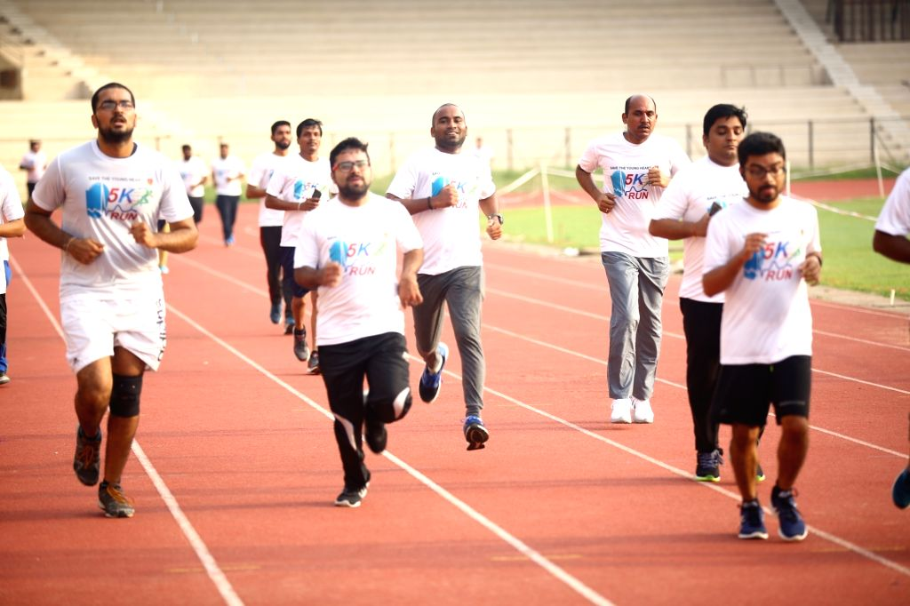 People participate in a 5K run on the occasion of World Heart Day, in Bengaluru, on 29 Sep, 2019.