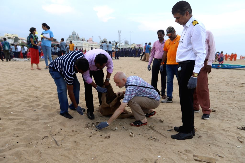 People participate in a beach clean-up drive organised jointly by U.S. Consulate General in Chennai and the Indian Maritime Foundation on the occasion of World Cleanup Day, near Ashtalakshmi ...