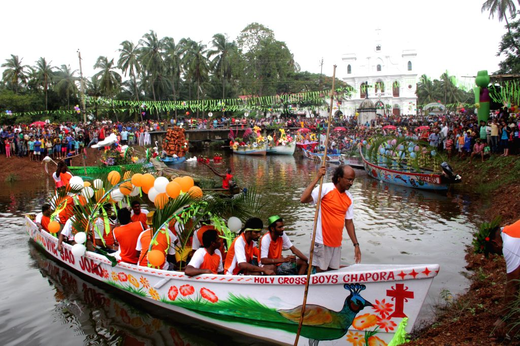 People participate in a boat festival organised on the occasion of Sao Jao Feast at Siolim (some 28 kms from Panaji) on June 24, 2015.