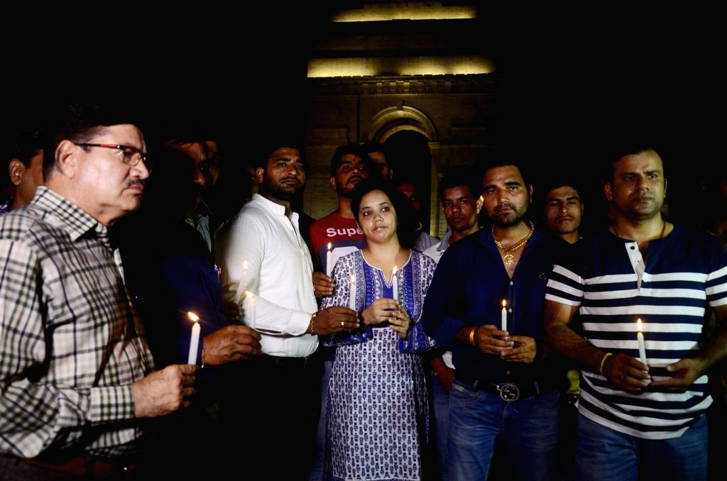 People participate in a candle light vigil over death of 7-year-old Pradyuman who was found dead by a school staff in Ryan international School's washroom with his throat slit; at India ...