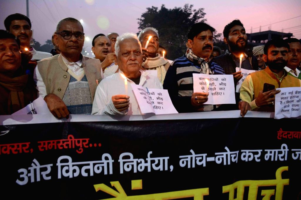People participate in a candle march to protest against gruesome gang rape and murder of a woman veterinarian in Hyderabad; in Patna on Dec 5, 2019.