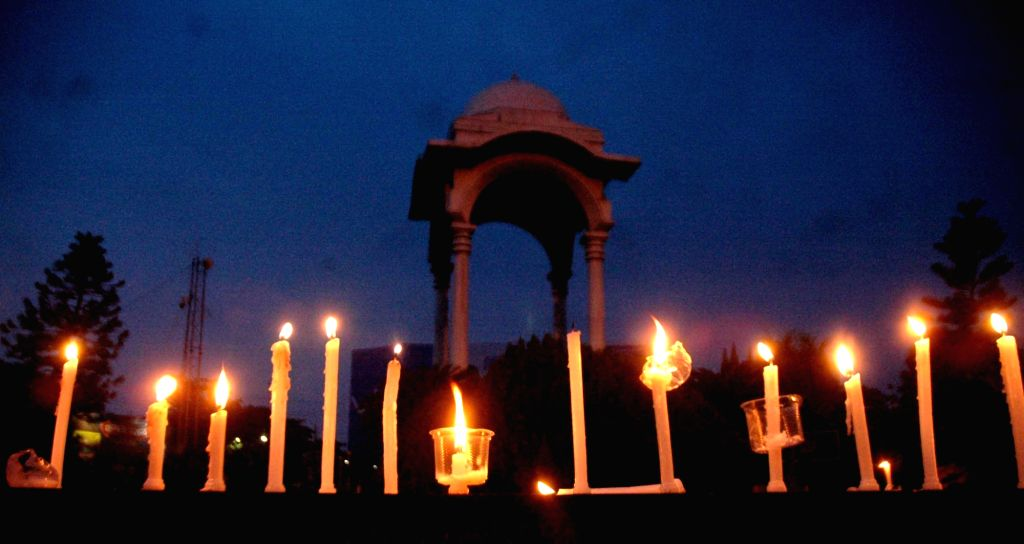 People participate in a candlelight vigil to condemn Sept 18 terror attack on army camp in Jammu and Kashmir's Uri, in Patna on Sept 20, 2016.