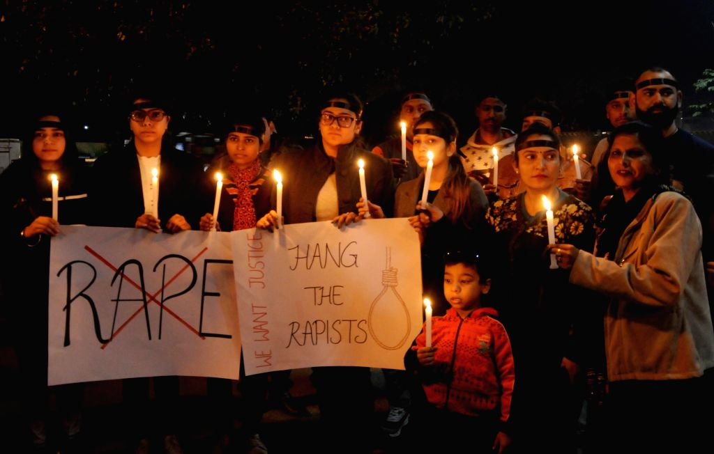 People participate in a candlelight vigil to express solidarity with the veterinarian who was gang raped and murdered in Hyderabad; demanding death penalty for the culprits, in Amritsar on ...