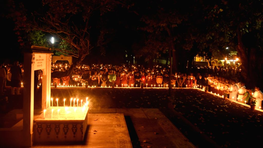 People participate in a candlelight vigil to pay tributes to the 49 CRPF men killed in 14 Feb Pulwama militant attack; in Santiniketan on Feb 16, 2019.