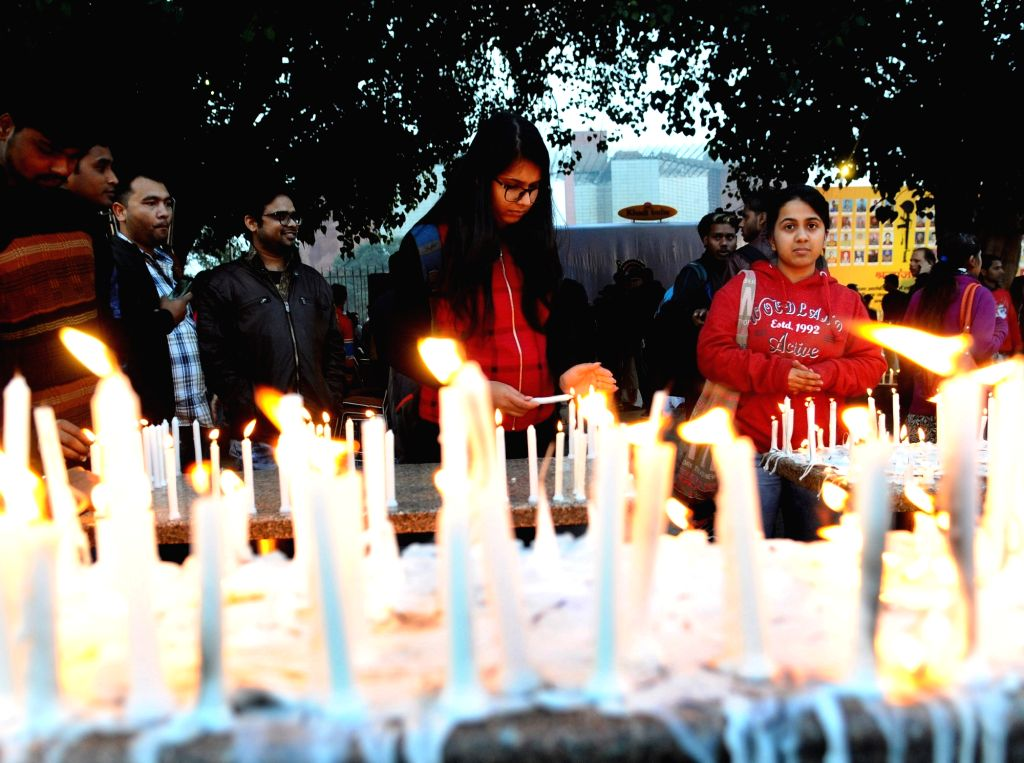 People participate in a candlelight vigil to pay tributes to 49 CRPF men killed in Jammu and Kashmir's Pulwama district militant attack on 14th Feb 2019; in New Delhi on Feb 17, 2019.
