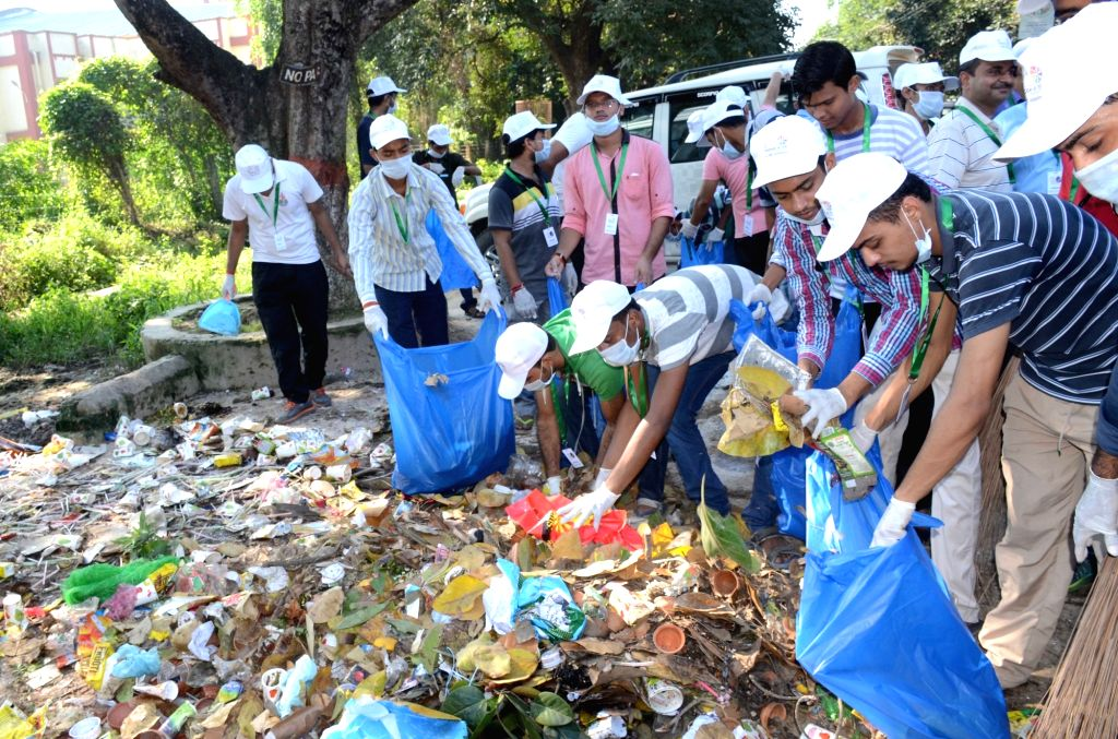 People participate in a cleanliness drive at Banaras Hindu University in Varanasi, on Oct 2, 2016.