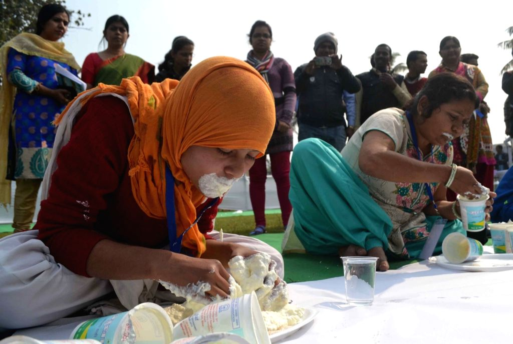 People participate in a curd eating competition in Patna, on Jan 18, 2016.