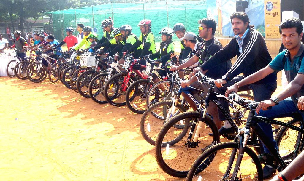 People participate in a cycle rally organised on `Cyclists' Day` at Shalini Grounds, in Bengaluru on Dec 21, 2014.