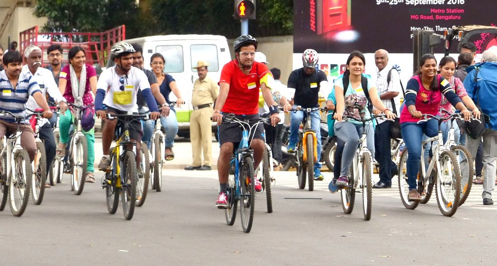 People participate in a cycle rally organised on World Tourism Day 2016 in Bengaluru on Sept 27, 2016.