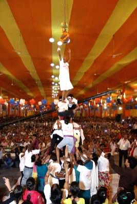 People participate in a `dahi-handi` competition organised on Janmashtami in Delhi on Aug 17, 2014.
