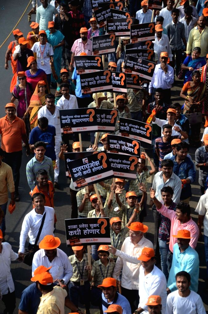"People participate in a ""Education Demand on KG to PG"" rally in Mumbai on Oct 15, 2016."
