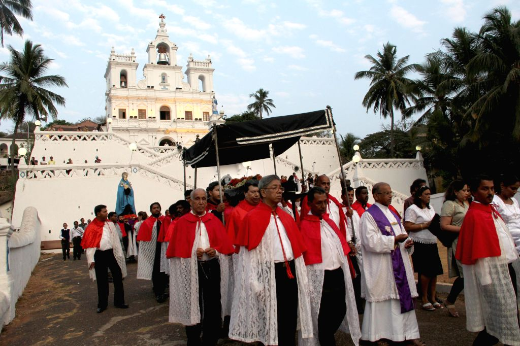 People participate in a Good Friday procession organised at Our Lady of the Immaculate Conception Church in Panaji on April 18, 2014.