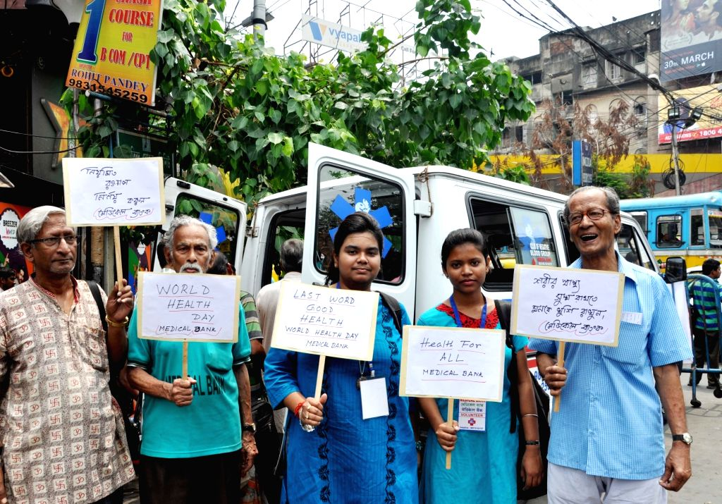 People participate in a health awareness rally on the occasion of World Health Day, in Kolkata on April 7, 2018.