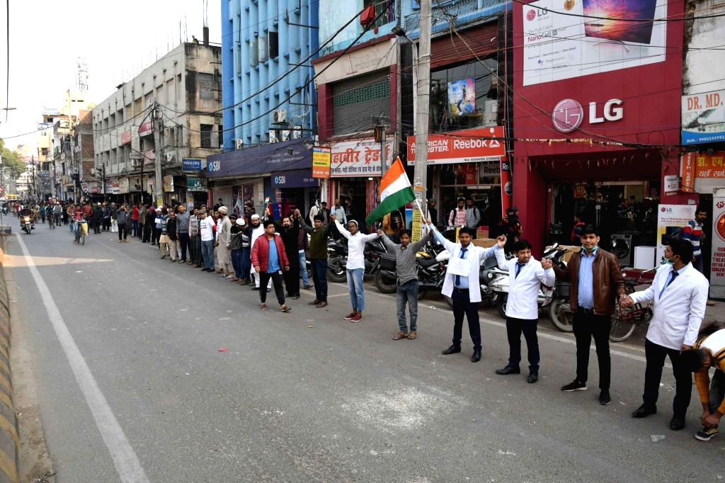 People participate in a human chain campaign to protest against the Citizenship Amendment Act (CAA) 2019, National Register of Citizens (NRC) and National Population Register (NPR), in Patna ...
