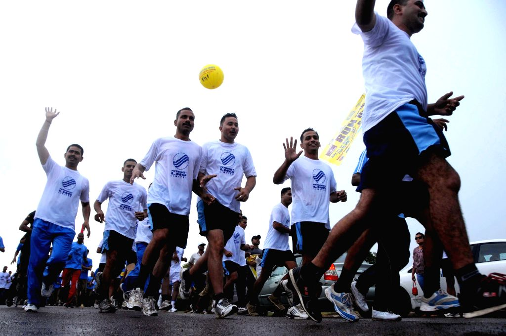 People participate in a marathon organised on United Nations' International Day Against Drug Abuse and Illicit Trafficking at India Gate in New Delhi on June 26, 2014.