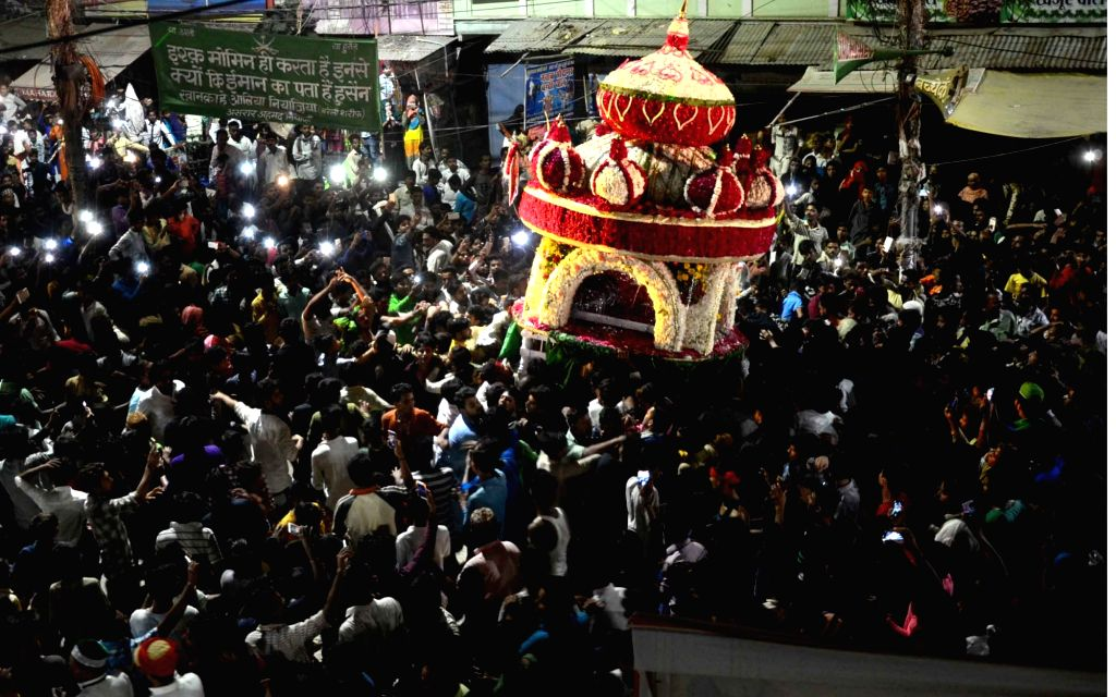 People participate in a 'Mehndi procession' during the Muslim month of Muharram, in Allahabad on Sept 15, 2018.