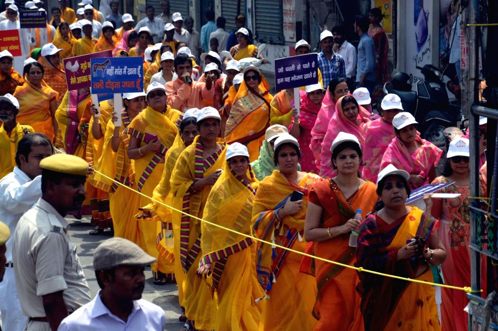 People participate in a procession organised on Mahavir Jayanti in Patna  on April 19, 2016.