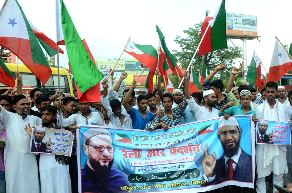 People participate in a rally in support of controversial Islamic preacher Zakir Naik and MIM chief Asaduddin Owaisi in Patna, on July 15, 2016.