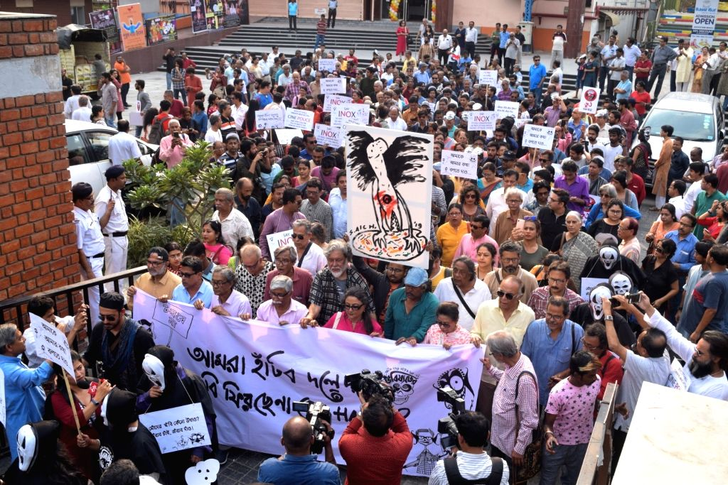 """People participate in a rally led by author Kalyan Ray and actress Aparna Sen, to protest against the withdrawal of Anik Dutta's film """"Bhobishyoter Bhoot (Ghost of the Future)"""" ... - Aparna Sen"""