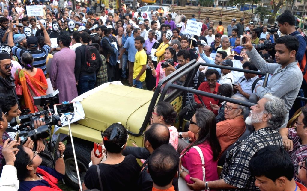 """People participate in a rally led by author Kalyan Ray and actors Aparna Sen and Soumitra Chatterjee, to protest against the withdrawal of Anik Dutta's film """"Bhobishyoter Bhoot (Ghost ... - Aparna Sen and Soumitra Chatterjee"""