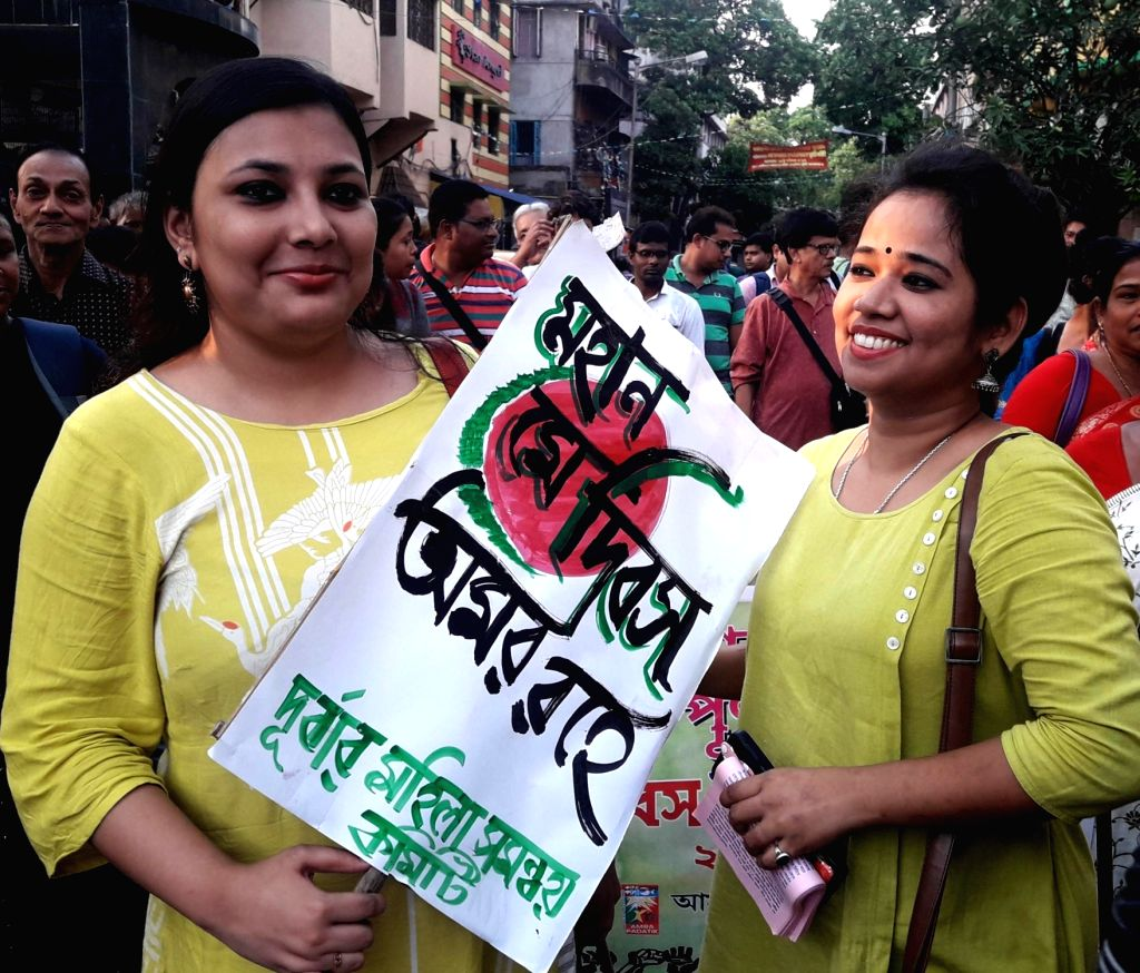 People participate in a rally organised by Durbar Mahila Samanwaya Committee on the eve of International Workers' Day in Kolkata, on April 30, 2019.