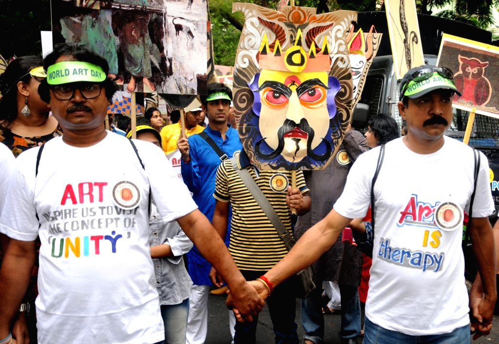 People participate in a rally organised to celebrate World Art Day, in Kolkata on April 15, 2019.