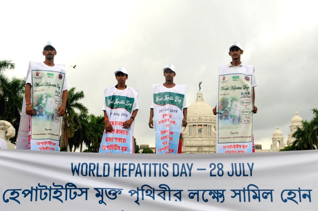 People participate in a rally to observe World Hepatitis Day in Kolkata, on July 28, 2019.
