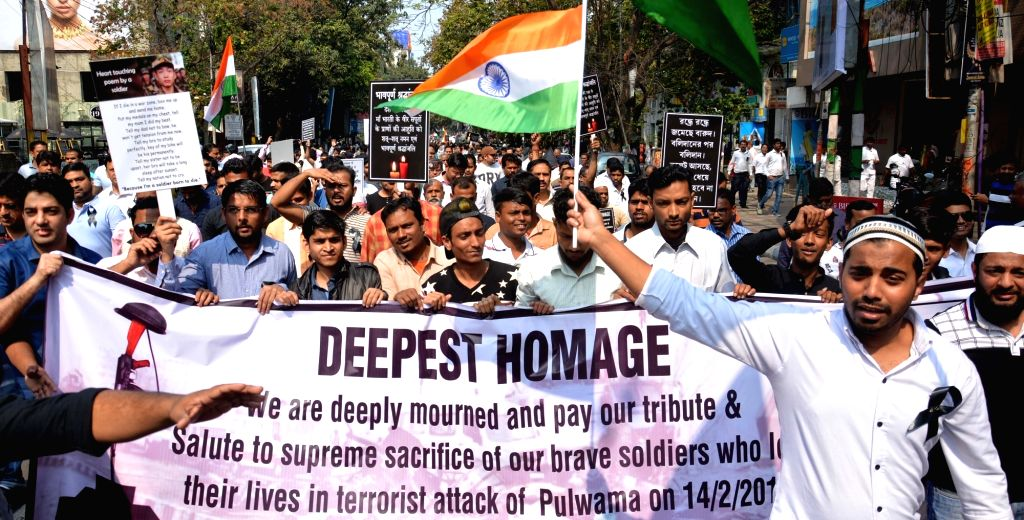 People participate in a rally to pay tribute to 49 CRPF men killed in Jammu and Kashmir's Pulwama district militant attack on 14th Feb 2019; in Kolkata, on Feb 17, 2019.